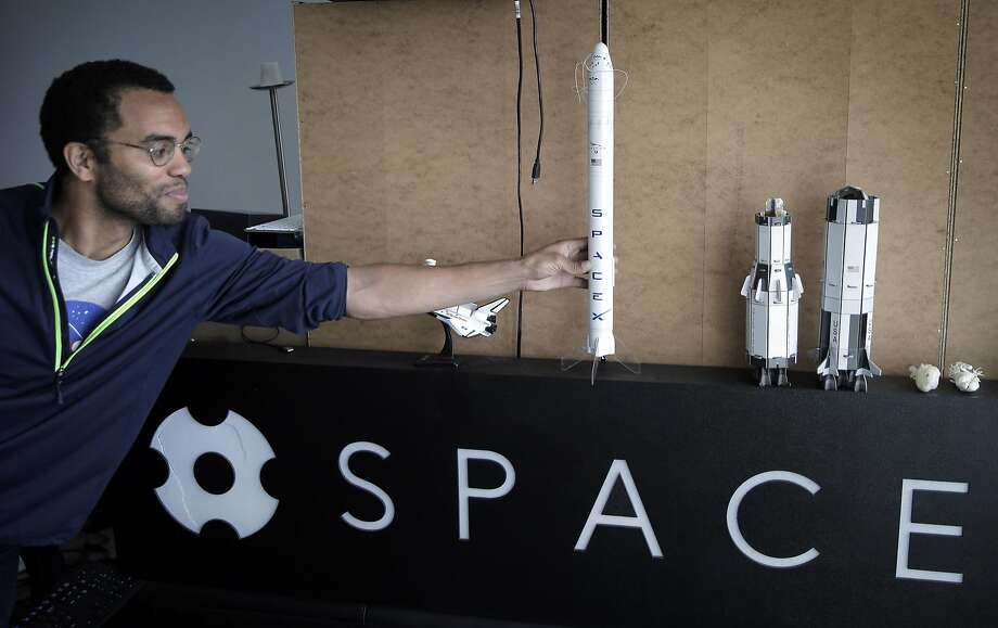 Chief Technology Officer Blaze Sanders picks up a scale model of a SpaceX spacecraft at the SpaceVR offices in San Francisco. The startup has a deal to get its shoebox-size satellite, the Overview 1, launched into space. Photo: Carlos Avila Gonzalez, The Chronicle