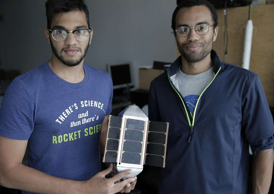 Lead space engineer Varun Vruddhula (left) and Chief Technology Officer Blaze Sanders hold a prototype of the Overview 1 satellite at the SpaceVR offices in San Francisco. Photo: Carlos Avila Gonzalez, The Chronicle