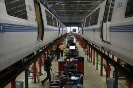 Mechanics and technicians work on BART cars at the BART Rolling Stock & Shops maintenance  department August 25, 2016 in Richmond, Calif.