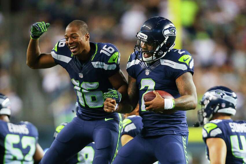 Seattle's Tyler Lockett (16) celebrates with quarterback Trevone Boykin (2) after Boykin scored off a 16-yard run during the third quarter of the pre-season game between the Seahawks and the Dallas Cowboys, Thursday, Aug. 25, 2016 at CenturyLink Field. Seattle won 27-17.