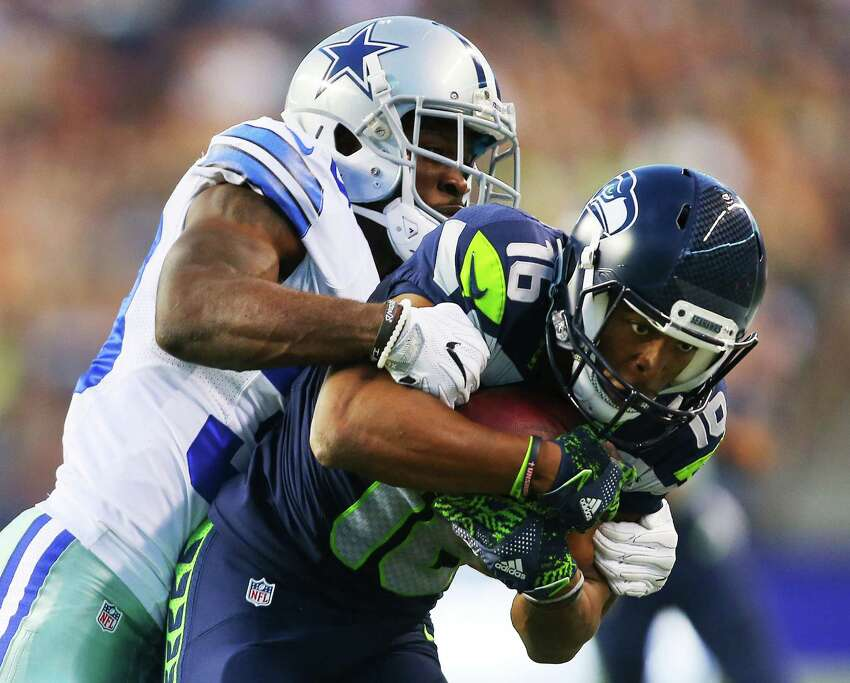 Dallas cornerback Anthony Brown, behind, tackles Seattle's Tyler Lockett as he drives towards the endzone during the first quarter of the pre-season game between the Seahawks and the Dallas Cowboys, Thursday, Aug. 25, 2016 at CenturyLink Field. Seattle won 27-17.