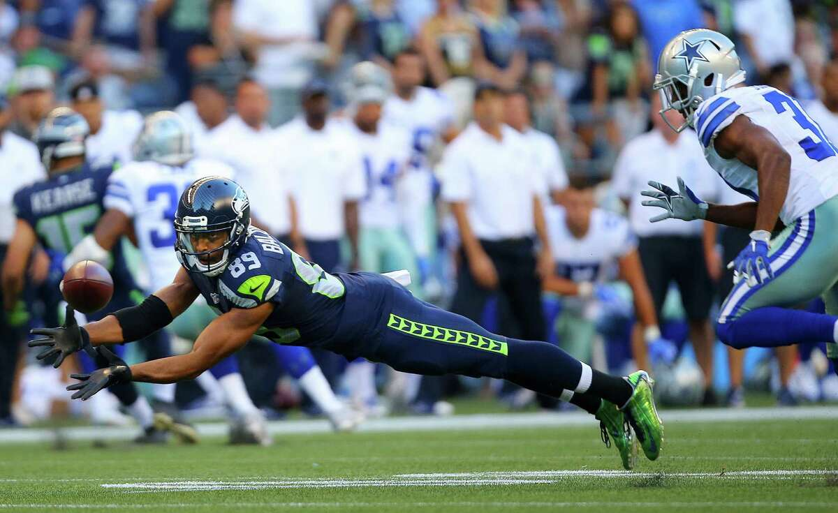 Seattle wide receiver Doug Baldwin (89) lays out to catch a pass during the first quarter of the pre-season game between the Seahawks and the Dallas Cowboys, Thursday, Aug. 25, 2016 at CenturyLink Field. Seattle won 27-17.