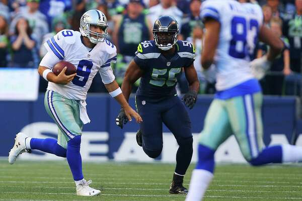 Dallas quarterback Tony Romo (9) runs the ball just before he is sacked by Cliff Avril (56) and sustains a back injury that took him out of the game during Dallas' first possession of the pre-season game between the Seahawks and the Dallas Cowboys, Thursday, Aug. 25, 2016 at CenturyLink Field. Seattle won 27-17.
