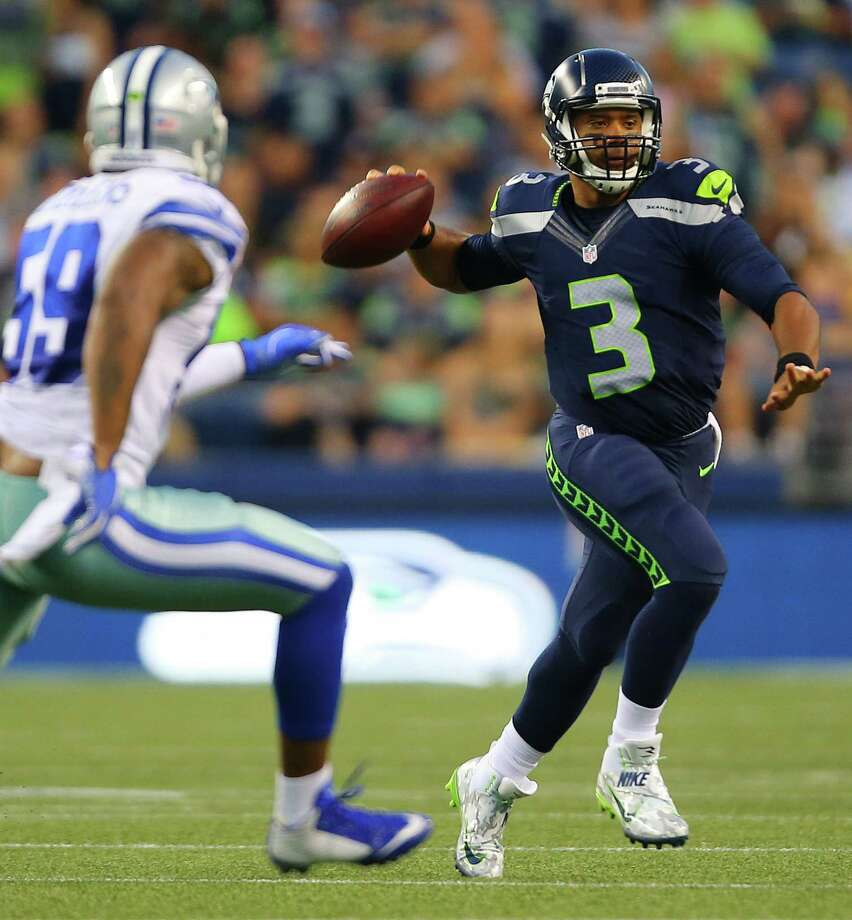 Seattle quarterback Russell Wilson looks to pass during the first half of the pre-season game between the Seahawks and the Dallas Cowboys, Thursday, Aug. 25, 2016 at CenturyLink Field. Seattle won 27-17. Photo: GENNA MARTIN, SEATTLEPI.COM / SEATTLEPI.COM