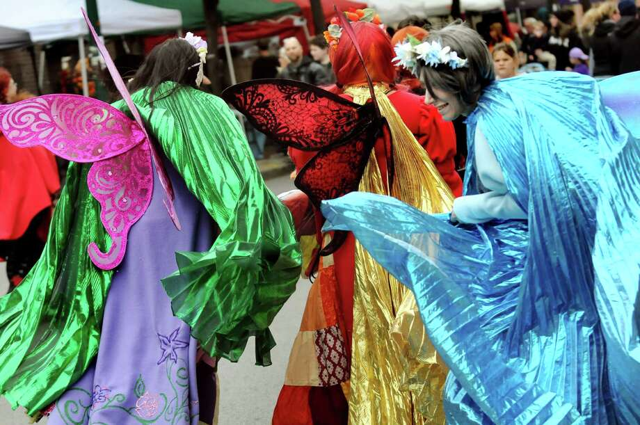 Costumes billow as the Antipode Geek Bellydancers stroll along River Street during the Enchanted City steampunk street festival on Saturday, Oct. 3, 2015, in Troy, N.Y. The family-friendly event offered music, games, performance, food and fantasy. (Cindy Schultz / Times Union) Photo: Cindy Schultz / 10033593A