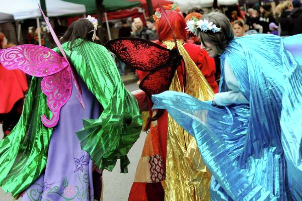Costumes billow as the Antipode Geek Bellydancers stroll along River Street during the Enchanted City steampunk street festival on Saturday, Oct. 3, 2015, in Troy, N.Y. The family-friendly event offered music, games, performance, food and fantasy. (Cindy Schultz / Times Union)