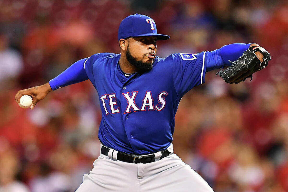 Jeremy Jeffress #23 of the Texas Rangers pitches in the seventh inning against the Cincinnati Reds at Great American Ball Park on August 23, 2016 in Cincinnati, Ohio. Cincinnati defeated Texas 3-0.