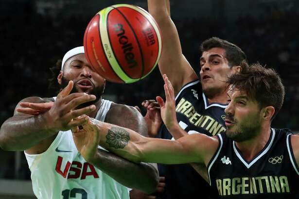 RIO DE JANEIRO, BRAZIL - AUGUST 17:  Demarcus Cousins #12 of United States goes for the ball alongside Nicolas Laprovittola #8 of Argentina during the Men's Basketball Quarterfinal game at Carioca Arena 1 on Day 12 of the Rio 2016 Olympic Games on August 17, 2016 in Rio de Janeiro, Brazil.