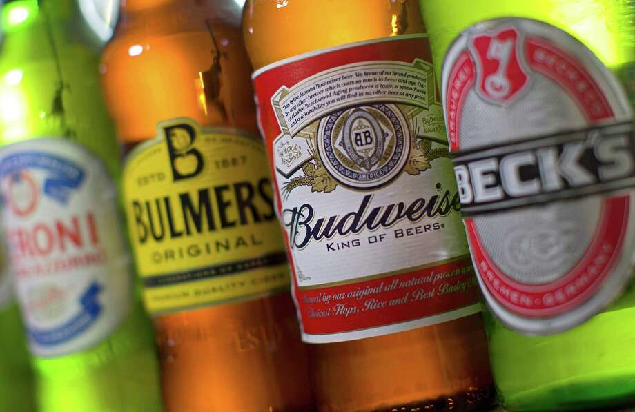 Anheuser-Busch InBev clinched its takeover of SABMiller after the British brewer's investors approved a $103 billion deal. The combined entity will account for one of every three beers sold worldwide. Photo: AFP /Getty Images /File Photo / AFP