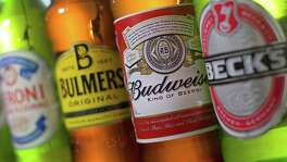 Anheuser-Busch InBev clinched its takeover of SABMiller after the British brewer's investors approved a $103 billion deal. The combined entity will account for one of every three beers sold worldwide.