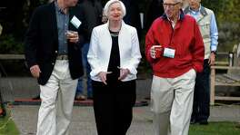 Federal Reserve Chair Janet Yellen strolls with Stanley Fischer (right), vice chairman of the Board of Governors of the Federal Reserve System, and Bill Dudley, the president of the Federal Reserve Bank of New York, before her Friday speech to the annual invitation-only conference of central bankers from around the world, at Jackson Lake Lodge in Grand Teton National Park, north of Jackson Hole, Wyo.