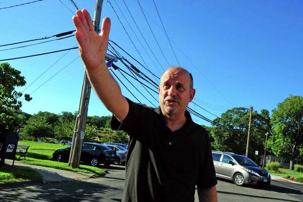 Resident Robert Sciortino talks about Broadway Road, which has been permanently closed at the intersection with Main Street in Trumbull, Conn., on Tuesday Aug. 23, 2016. Sciortino as well as business owners along the road are displeased with the town's decision to close off the road from Main Street, making it harder for motorists to get into the new plaza and leave from Whitney Avenue.
