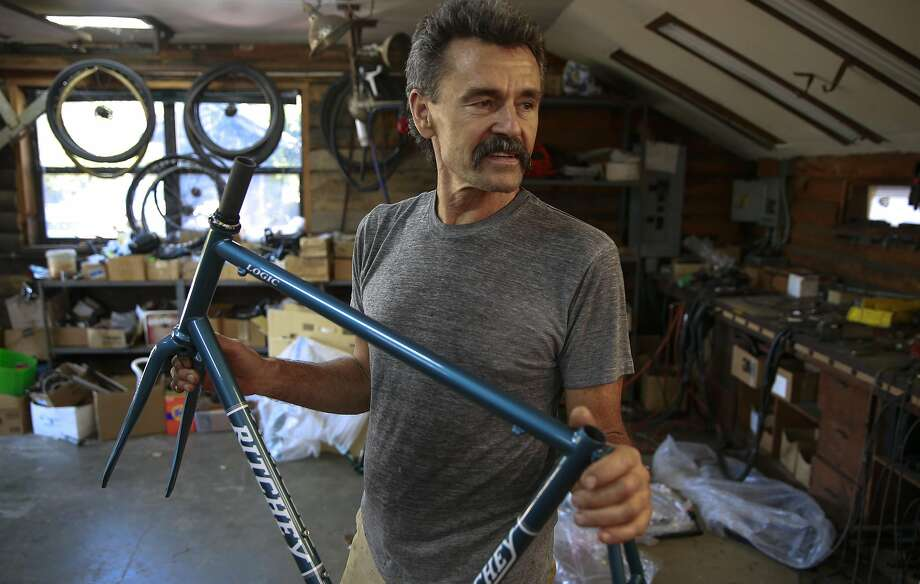 Tom Ritchey holds a bike frame designed in his workshop at his home in Woodside. He got started as a custom frame builder in the 1970s. Photo: Michael Macor, The Chronicle