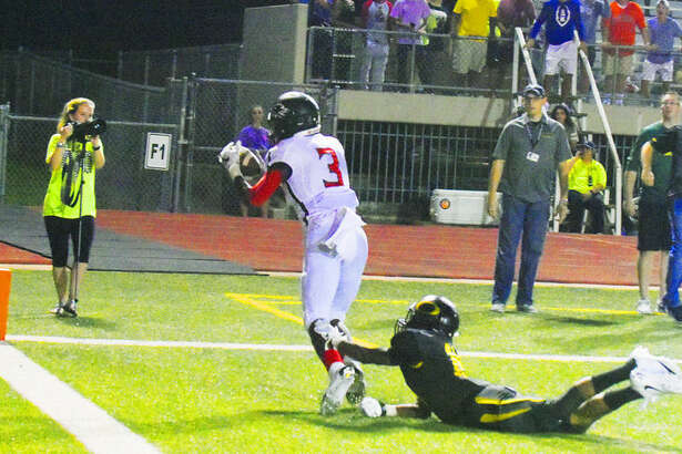Langham Creek junior wide receiver Golden Eke reels in the ball for a game-saving touchdown reception against the Klein Oak defense as time expires Thursday. Eke's touchdown set up the dramatic walk-off two-point conversion to win the game from Praise Okorie on the following play.
