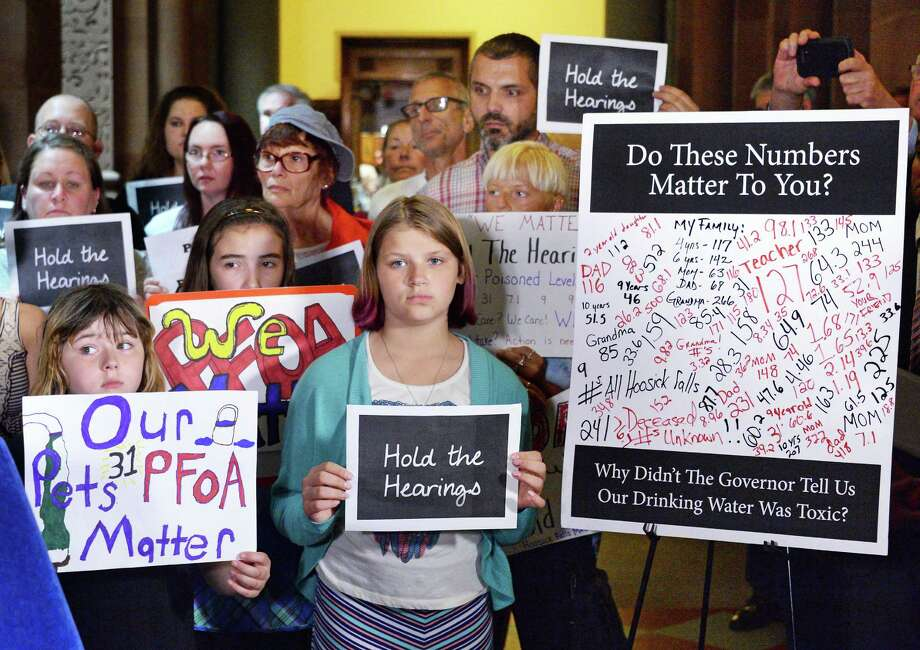 Hoosick Falls residents rally at the Capitol to call for hearings on PFOA in June. The state Senate will hold a hearing on the water crisis Tuesday at Hoosick Falls High School.  (John Carl D'Annibale / Times Union) Photo: John Carl D'Annibale / 40036986A