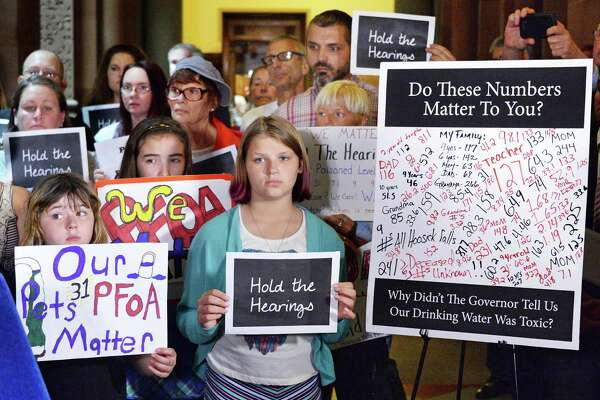 Hoosick Falls residents rally at the Capitol to call for hearings on PFOA in June. The state Senate will hold a hearing on the water crisis Tuesday at Hoosick Falls High School.  (John Carl D'Annibale / Times Union)