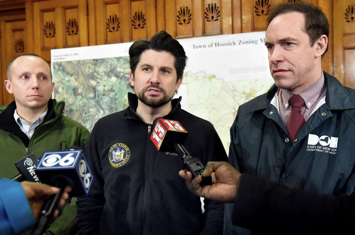 State Operations Director Jim Malatras, center, speaks during a news conference on Saturday, Feb. 13, 2016, at HAYC3 Armory in Hoosick Falls, N.Y. Joining him are DEC Acting Commissioner Basil Seggos, left, and DOH Commissioner Howard Zucker. (Cindy Schultz / Times Union)