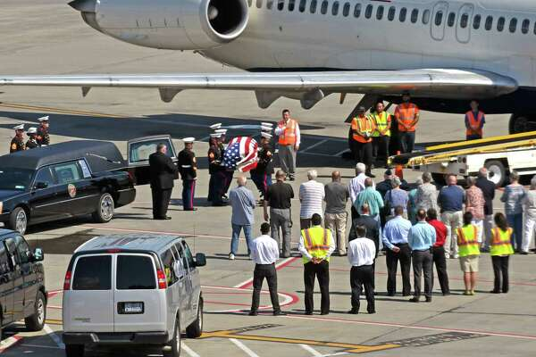 After nearly 73 years, the remains of U.S. Marine Corps Pfc. George H. Traver, of Chatham, who was killed in combat in the Pacific during World War II, are finally cane home. Marines will escorted the flag-draped coffin and family members will received the remains on the airfield before Patriot Guard riders and a motorcade carried the remains to his hometown of Chatham from Albany international Aiport on Friday Aug. 26, 2016 in Colonie, N.Y. (Michael P. Farrell/Times Union)