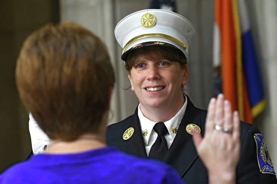Mayor Kathy Sheehan swears in Maria Walker into her new position at Albany City Hall on Friday, Aug. 26, 2016 in Albany, N.Y. Walker is the first female to be promoted to deputy chief in the Albany Fire Department. (Lori Van Buren / Times Union) Photo: Lori Van Buren / 20037804A