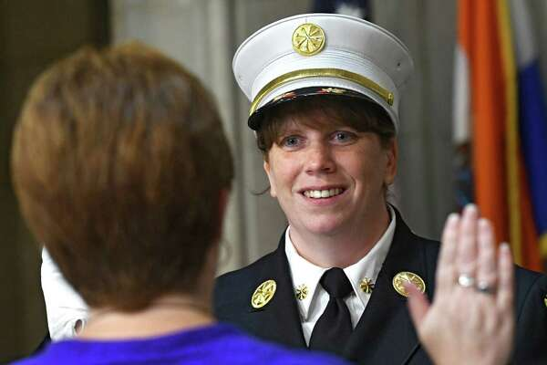 Mayor Kathy Sheehan swears in Maria Walker into her new position at Albany City Hall on Friday, Aug. 26, 2016 in Albany, N.Y. Walker is the first female to be promoted to deputy chief in the Albany Fire Department. (Lori Van Buren / Times Union)