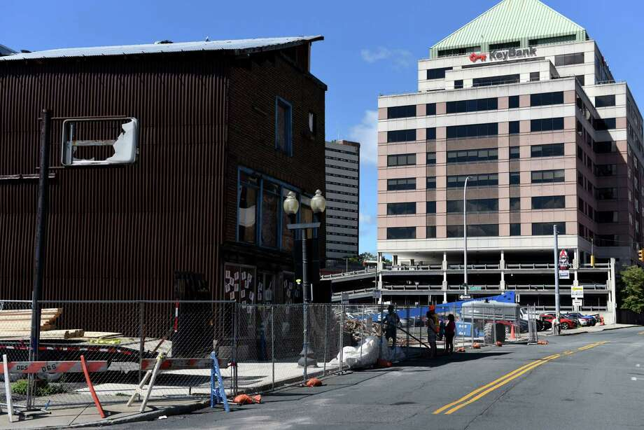 Work continues to preserve the structure at 48 Hudson Ave., Albany's oldest building, left, on Monday, Aug. 22, 2016, in Albany, N.Y. Fifty Hudson was demolished last week after a structural crack was spotted on the building. (Will Waldron/Times Union) Photo: Will Waldron