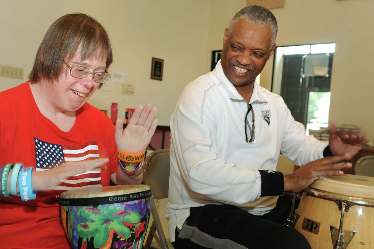 Sherrie Berglune, left, plays along with percussionist Steve Scales during the weekly drumming circle he holds with clients from the Kennedy Center, held at St. Andrews Church in Milford, Conn. Aug. 25, 2016. Scales, known for his works with recording artists including the Talking Heads, has been working with the Kennedy Center while he completes a Bachelor of Science in Human Services at the University of Bridgeport.