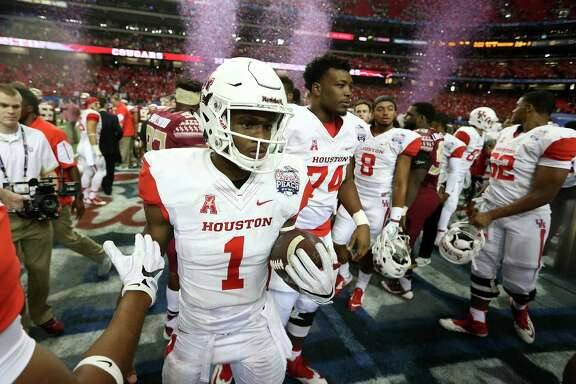 Houston Cougars quarterback Greg Ward Jr. (1) holds onto the game ball as the Houston Cougars celebrate their 38-24 win over Florida State University  in the Chick-fil-A Peach Bowl at the Georgia Dome on Thursday, Dec. 31, 2015, in Atlanta.  ( Elizabeth Conley / Houston Chronicle )