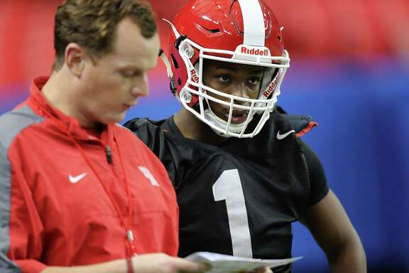 Houston Cougars offensive coach Major Applewhite  talks to Houston Cougars quarterback Greg Ward Jr. (1) during practice at the Georgia Dome on Tuesday, December 29, 2015. University of Houston Cougars football team practice at the Georgia Dome on Tuesday, Dec. 29, 2015, in Houston. ( Elizabeth Conley / Houston Chronicle )