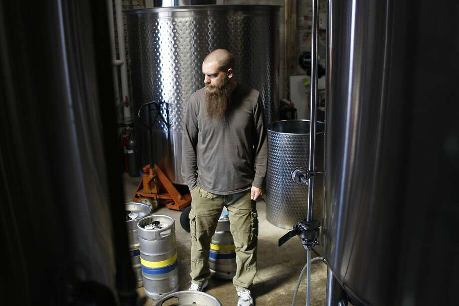 Founder Adam Lamoreaux checks the tanks at the Linden Street Brewery in Oakland. Photo: Liz Hafalia, The Chronicle