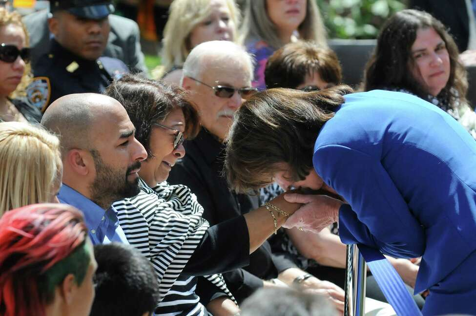 Lt. Gov. Kathy Hochul, right, kisses the hand of Maria DeJesus during a police officers memorial ceremony on Tuesday, May 5, 2015, at the State Police Memorial in Albany, N.Y. DeJesus lost her son NYPD Officer Anthony DeJesus. Officers, who died from line of duty injuries in 2014, were honored. (Cindy Schultz / Times Union archive)