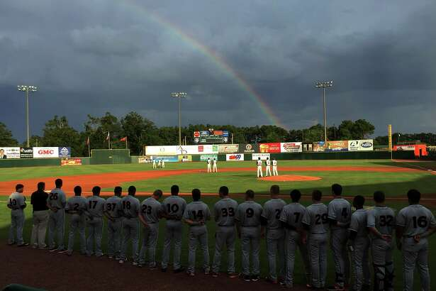 A rainbow arches the sky over Lake Olmstead Stadium during the playing of the national anthem as the single A Augusta GreenJackets play the Delmarva Shorebirds in Augusta Ga., July 15, 2016.