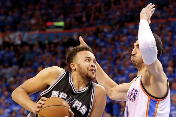 Spurs' Kyle Anderson looks for room around Oklahoma City Thunder's Enes Kanter during second half action of Game 6 in the Western Conference semifinals on May 12, 2016 at Chesapeake Energy Arena.