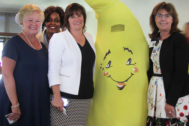 Chaplain Anna Gentile, Rhonda Neal of Guideposts, Kelly Mangold of Guideposts and Susan Kania of Western Connecticut Health Network pose with Sparkle during a celebration marking the 10th year of the Guideposts for Kids Comfort Kits at the Guidepost offices at the Matrix in Danbury, Conn., on Wednesday, Aug. 24, 2016.