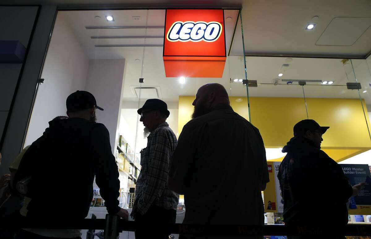Lego fans, including Drew Dirschell (center), are the first in line for the grand opening of the new Lego store at Westfield SF Centre shopping mall in San Francisco, Calif. on Aug. 26, 2016.