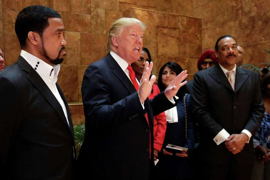 """FILE - In this April 18, 2016 file photo, Pastor Darrell Scott listens at left as Republican presidential candidate Donald Trump speaks in Trump Tower building in New York. Competing appearances earlier this month by Trump and Hillary Clinton highlight an oft-overlooked political reality: The """"religious vote"""" is vast and complex, and it extends beyond generalizations about """"social conservatives"""" who side with Republicans and black Protestant churches whose pastors and parishioners opt nearly unanimously for Democrats. (AP Photo/Richard Drew, File) Photo: Richard Drew / Associated Press / Copyright 2016 The Associated Press. All rights reserved. This material may not be published, broadcast, rewritten or redistribu"""