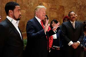 "FILE - In this April 18, 2016 file photo, Pastor Darrell Scott listens at left as Republican presidential candidate Donald Trump speaks in Trump Tower building in New York. Competing appearances earlier this month by Trump and Hillary Clinton highlight an oft-overlooked political reality: The ""religious vote"" is vast and complex, and it extends beyond generalizations about ""social conservatives"" who side with Republicans and black Protestant churches whose pastors and parishioners opt nearly unanimously for Democrats. (AP Photo/Richard Drew, File)"