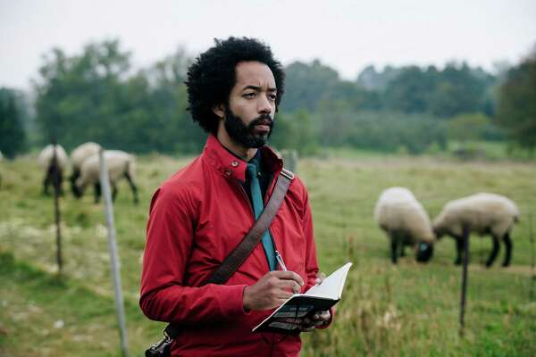 """Wyatt Cenac plays a journalist covering an alien-abduction support group in the unnerving """"People of Earth,"""" premiering Oct. 31."""