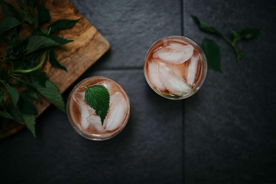 Strawberry Shiso Shrubs, over ice. Photo: Nik Sharma