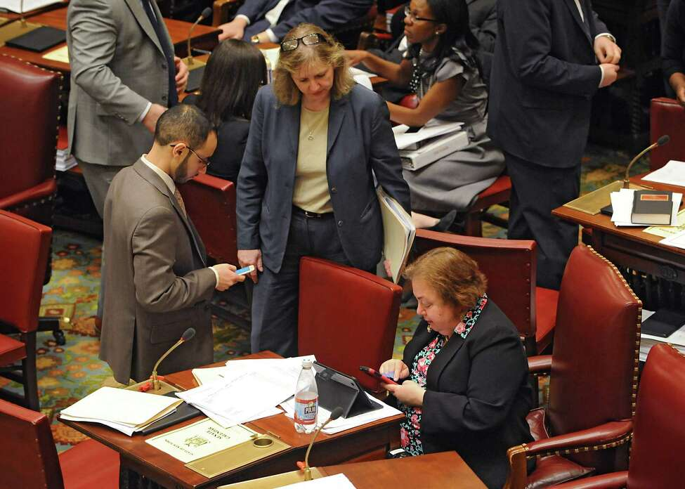 Senator Liz Krueger, right, uses her phone in the Senate chamber at the Capitol on Monday, March 14, 2016, in Albany, N.Y. (Lori Van Buren / Times Union archive)