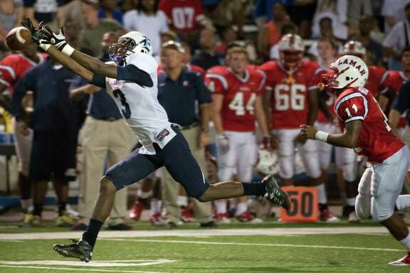 Ishmael Zamora, then a wide receiver for Elsik High School, has a pass go off his fingertips in a game against Lamar in 2012. Zamora now plays for Baylor, and a reader says a recent animal cruelty incident involving Zamora is a sad reflection of the entire football program at the university.