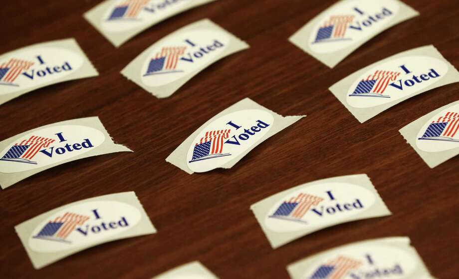 Voting is a duty for all U.S. citizens. There is, however, a corresponding duty for election officials to ensure that everyone eligible is allowed to exercise that right, free of misinformation (intentional or not) or intimidation. Photo: Charlie Neibergall /Associated Press / AP