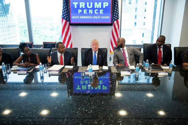 Republican presidential candidate Donald Trump meets with minority leaders, including former primary opponent Ben Carson (second left) on Thursday at Trump Tower in New York. Readers comment on the candidate, both pro and con.