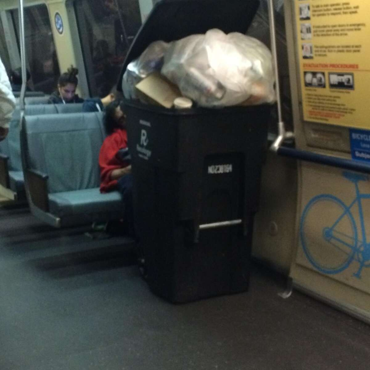 Houston Garcia snapped this photo of a man transporting a stuffed garbage can on BART.