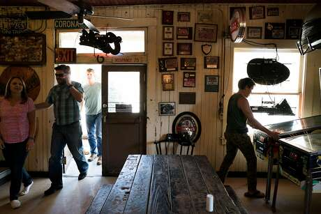 Diners enter the Alpine Inn in Portola Valley, Calif. on Friday, Aug. 26, 2016. On August 27, 1976 scientists from SRI International sent an electronic message from a computer behind the Alpine Inn to Boston. Photo: James Tensuan, Special To The Chronicle