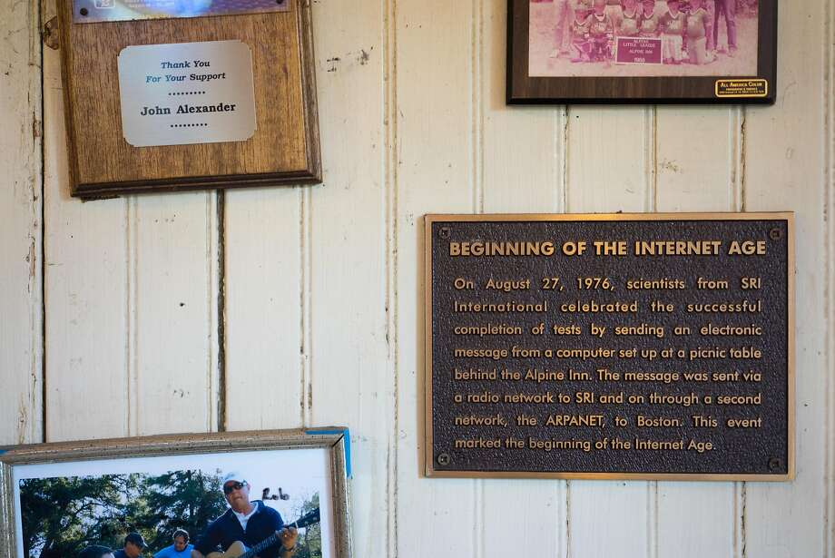 A plaque notes the Beginning of the Internet Age in Portola Valley. On Aug. 27, 1976, a message was sent from a computer behind the Alpine Inn to Boston. Photo: James Tensuan, Special To The Chronicle