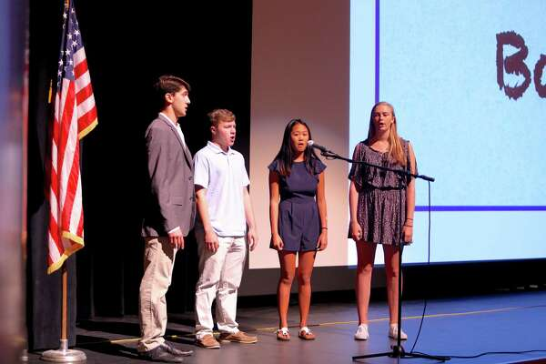 Cameron Liflander, Jake Montgomery, Lily Nobunaga and Katie Hoffmeister sing The Star Spangled Banner during the convocation ceremony for all Greenwich Public School teachers held inside the auditorium at Greenwich High School August 26, 2016.