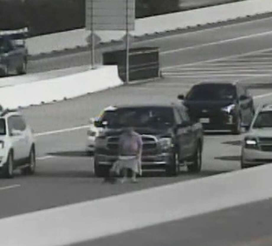 An unidentified woman saved a cat on the Sam Houston Tollway at Westview on Aug. 24, 2016.Officials with the Harris County Toll Road Authority recommend not disrupting traffic to save animals.Click through the slideshow to see some of the most congested highways in America. Photo: Harris County Toll Road Authority