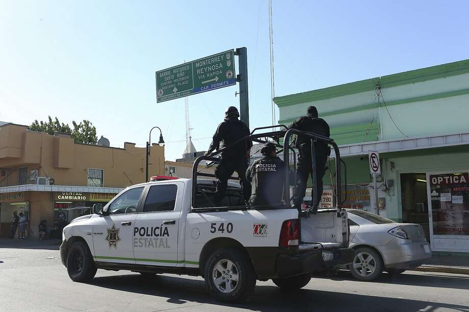 File photo of the Tamaulipas State Police in Nuevo Laredo, Mexico. An American family returning to the U.S. after a holiday visit to Mexico came under attack just south of Texas on Saturday night. Photo: Jerry Lara, San Antonio Express-News