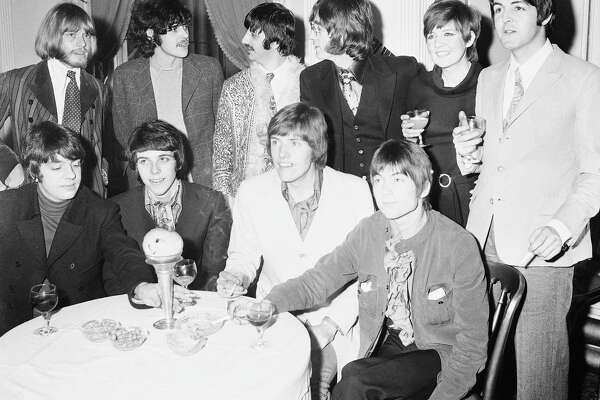 In 1968, Donovan, rear and second from left, mingled with other big acts. Front, from left: George Alexander, Pete Swettenham, Geoffrey Swettenham and John Perry of Grapefruit. Rear left, Brian Jones of the Rolling Stones, Ringo Starr and John Lennon, center, Cilla Black and Paul McCartney.