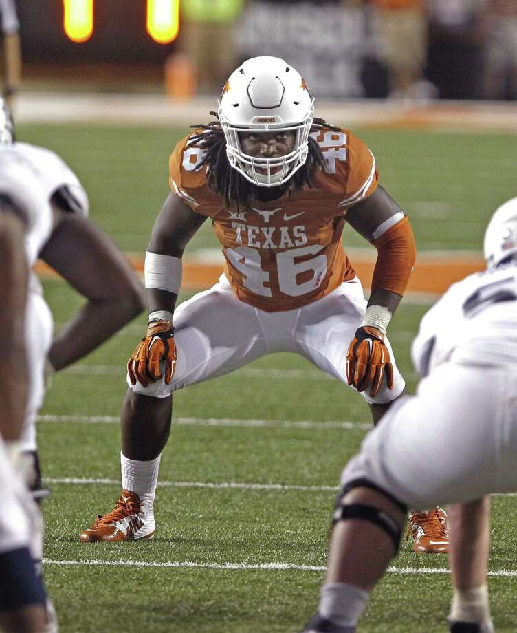 Texas' Malik Jefferson will move back to outside linebacker after struggling last year in the middle. Photo: Michael Thomas / Associated Press / FR65778 AP